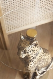 Image from above of the Antique Gold Leopard Side Table With Glass Top