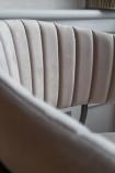 Side angle close-up image of the Curved Back Velvet Bar Stool In Mink Grey