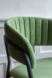 Close-up of the curved back on the Velvet Bar Stool In Moss Green
