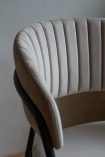 Close-up of the curved back on the Velvet Dining Chair In Mink Grey