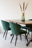 Lifestyle image of the Rich Green Deco Velvet Dining Chair around a table