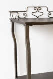 Close-up image of the Distressed Iron Side Table With Wire Detail Back