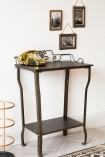 Image of the Distressed Iron Side Table With Wire Detail Back with a telephone on it