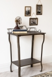 Angled lifestyle image of the Distressed Iron Side Table With Wire Detail Back