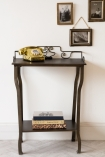 Front-on lifestyle image of the Distressed Iron Side Table With Wire Detail Back