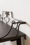 Close-up image of the right hand side of the wire detail on the Distressed Iron Side Table