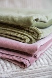 Image of the Moss Green and Dusky Pink Velvet Throws together