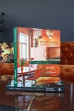 Lifestyle image of Extraordinary Interiors in Colour by Jane Rockett & Lucy St George standing up on the first book