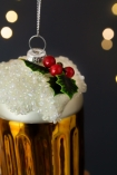 Close-up image of the holly decoration on the Festive Beer Hanging Christmas Decoration