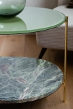 Close-up image of the shelf and top of the Forest Green Oval Marble & Brass Coffee Table