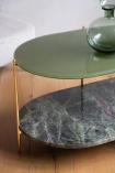 Angled image of the shelf and top on the Forest Green Oval Marble & Brass Coffee Table