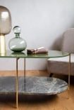 Lifestyle image of the Forest Green Oval Marble & Brass Coffee Table