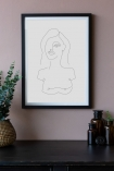 Close-up lifestyle image of the White Self Portrait Art Print hanging on a wall framed