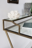 Image of the side of the Glass Desk/Dressing Table With Antique Gold Frame showing the shelf