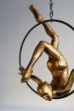 Close-up image of the Gold Acrobatic Hanging Lady