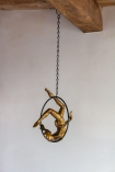 Image of the Gold Acrobatic Hanging Lady hanging from the ceiling