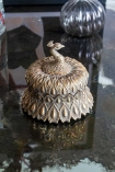 Panned out lifestyle image of the Antique Style Gold Peacock Trinket Box with the lid on