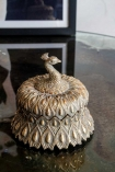 Lifestyle image of the Antique Style Gold Peacock Trinket Box with the lid on