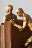 Close-up image of the Antique Gold Strong Man Bookends