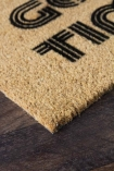 Close-up image of the Come In For The Good Times Doormat