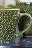 Close-up image of the handle and detail on the Moss Green Fern Leaf Design Mug