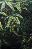 Close up detail image of the pattern on the Green Jungle Leaf Velvet Cushion