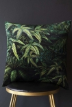 Lifestyle image of the Green Jungle Leaf Velvet Cushion