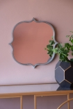 Front-on lifestyle image of the Indoor Or Outdoor Marrakesh Mirror hanging on the wall