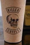 Close-up image of the print on the front of the Killer Coffee Reusable Cork Coffee Cup