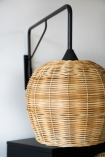 Close-up image of the Large Directional Wall Light with Sphere Wicker Shade