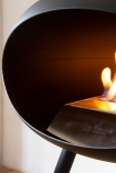 Close-up image of the Le Feu Ground Wood Eco Fireplace lit