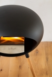 Image of the back of the Le Feu Ground Wood Eco Fireplace lit