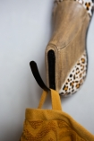 Close-up image of the hook on the Leopard Print Wooden Shoe Wall Hook
