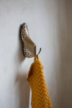 Side angle image of the Leopard Print Wooden Shoe Wall Hook