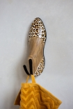 Close-up lifestyle image of the Leopard Print Wooden Shoe Wall Hook
