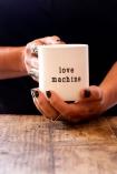 Hands holding the Love Machine Mug