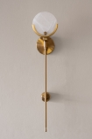 Front-on image of the Marble Disc & Brass Wall Light on the wall