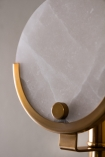 Close-up of the marble disc element of the Marble Disc & Brass Wall Light