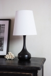 Image of the Beautiful Black Wooden Table Lamp With White Lamp Shade on a sideboard