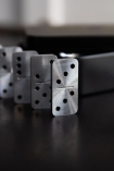 Image of the domino's from the Mini Travel Domino Set standing up