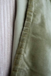 Close-up image of the seam on the Moss Green Velvet Throw