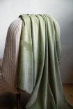 Close-up lifestyle image of the Moss Green Velvet Throw