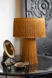 Lifestyle image of the Mustard Yellow All Over Fringe Table Lamp