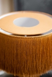 Close-up image of the top of the Mustard Yellow All Over Fringe Table Lamp