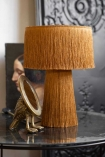 Close-up lifestyle image of the Mustard Yellow All Over Fringe Table Lamp