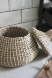 Lifestyle image of the Seagrass Basket with the lid off and to the side