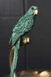 Close-up image of the parrot on the Emerald Green Parrot Perched On A Leaf Ornament
