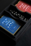 Close-up image of the inside of the Quality Playing Cards In Studded Ace Wooden Box