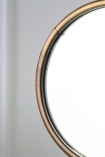 Close-up image of the mirror on the Bronze Bird Feet Table/Vanity Mirror