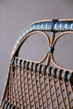 Close-up image of the detail on the back of the Black & Natural Beautiful Rattan Lounge Chair